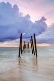 old miner bridge in the kaopilay beach at sunset time slow shutter