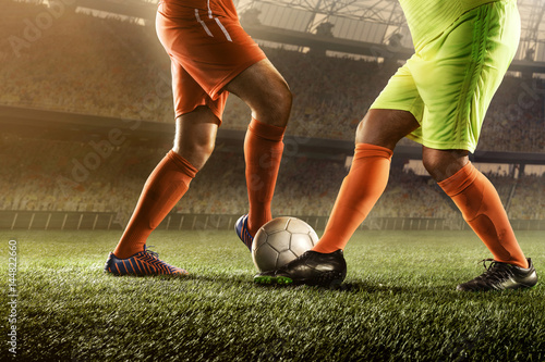 soccer players fighting for a ball