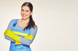Portrait of smiling woman dressed cleaner uniform with crossed arms. - 144833408