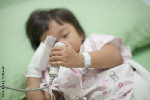 One child is pressing the emergency button, signaling for help from the medical team Poster