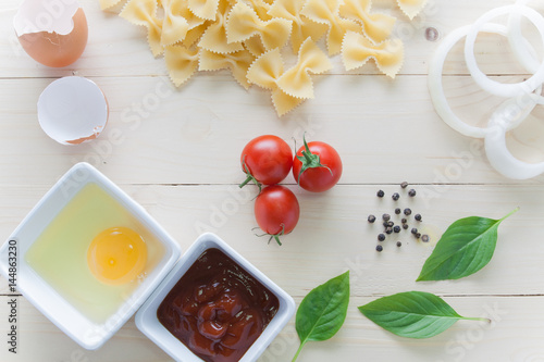 Plagát, Obraz spaghetti with ingredients for cooking on wood background
