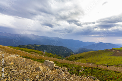 Beautiful mountainscape with cloudy sky and cableway