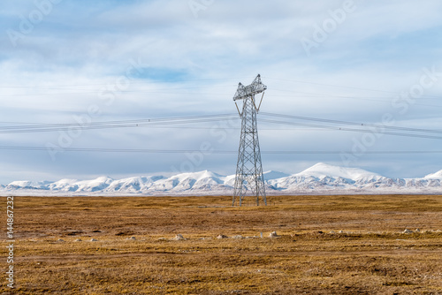 Poster power transmission towers on plateau