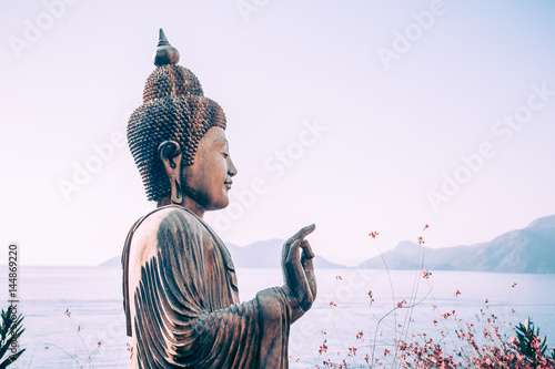 Buddha statue outdoors near the sea