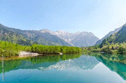 Hotaka mountain range reflect on taisho ike pond in spring at kamikochi national Poster
