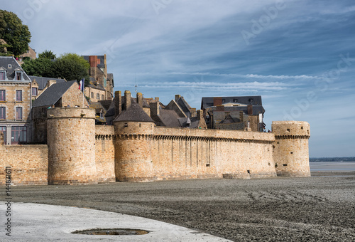 Poster Panoramic view on the stone wall fortifications of Mont-Saint-Michel abbey, Fran