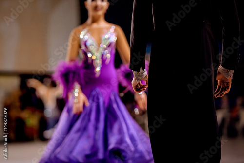back male dancer athlete in black tailcoat and woman dancer in bright dress - 144873029