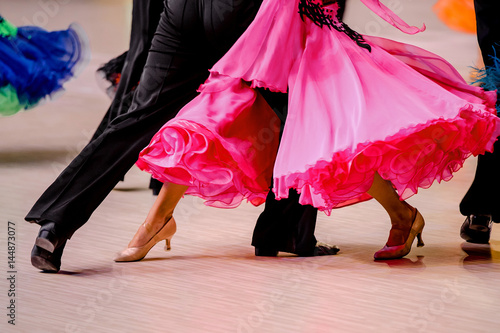 competitions in ballroom dancing. black tailcoat and pink ball gown - 144873077