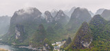 Beautiful karst mountains and the Li River at mist weather. View from the hill above town of the Hingping - China