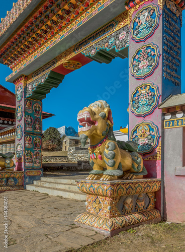 One of the two mythical beasts (right) guarding the gate of the Tengboche monast Poster