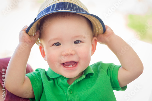 Poster Portrait of A Happy Mixed Race Chinese and Caucasian Baby Boy Wearing His Hat