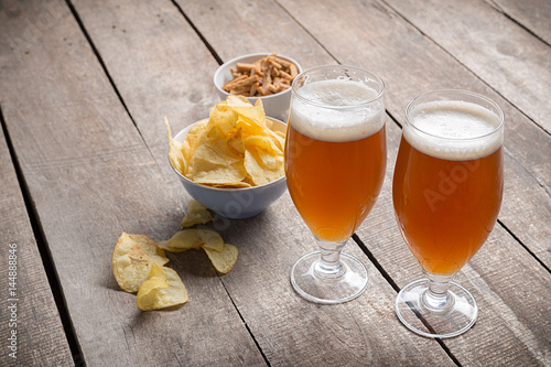 glass beer on wood background Poster