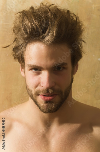 Handsome bearded man with beard and stylish haircut