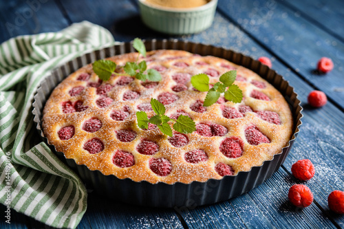 Juicy raspberry pie with powdered sugar icing