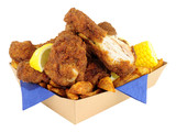 Southern fried chicken portions in a cardboard take away tray isolated on a white background - 144896499
