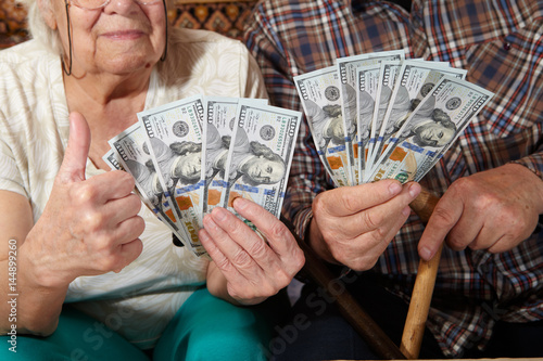 Old couple and money. Poster