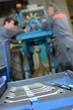 Постер, плакат: Closeup of set of spanners mechanics in background