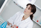 young female doctor with test tube