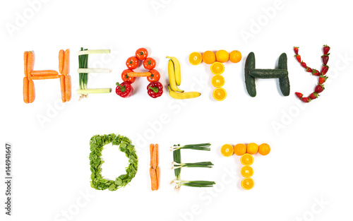 HEALTHY DIET text made out of fruits and vegetables isolated on white background