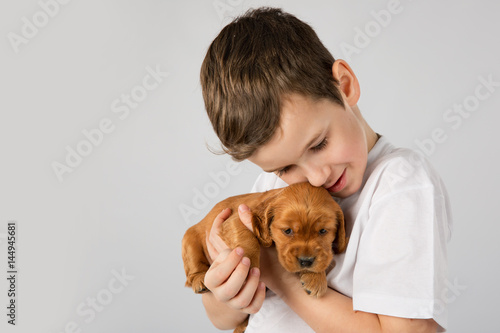 Poster Boy with red puppy isolated on white background