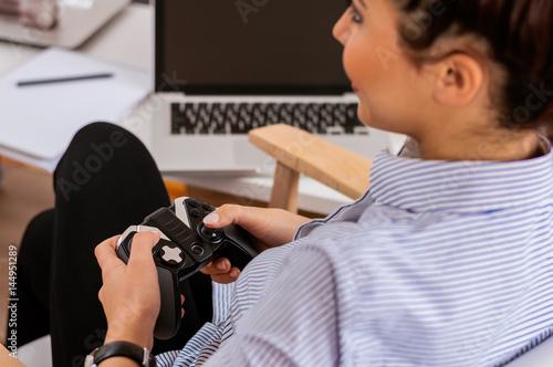 Poster Girl playing games, using joystick