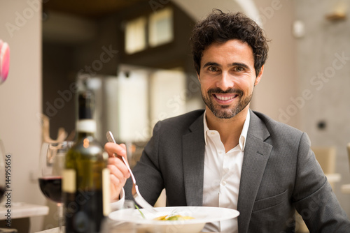 Man eating in a restaurant - 144955656