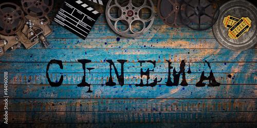 Cinema concept of vintage film reels, clapperboard and projector. Poster