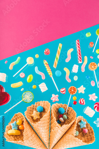 Close-up view of crispy waffle cones with different gourmet candies Poster