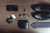 Accessories groom's wedding day. Wallet watch cufflinks tie shoes mobile phone car keys
