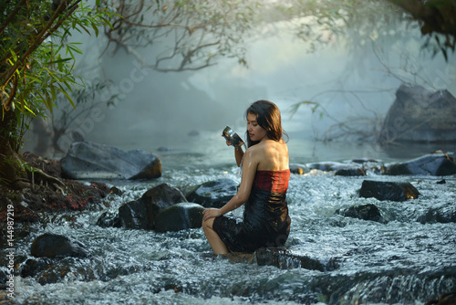 young woman relaxing in hot springs,Woman enjoy onsen in Thailand,Asian woman we Poster
