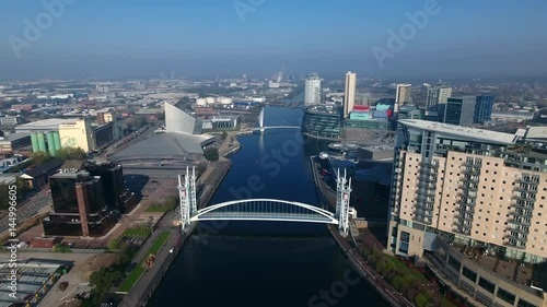 Rising aerial view of Media city and Salford Quays, Manchester, England.