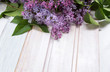 Fresh lilac flowers on a wooden table