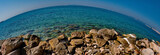 rocks on a sea. a picture of rocks on a sea in a beach resort,in athens greece in a summer day of april