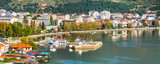 Panoramic aerial view of houses, people near lake and and pier in Ohrid, Republic of Macedonia