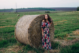 A girl in haystacks