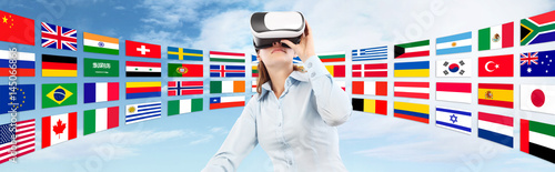Learn languages in the future technology concept, Woman wearing virtual reality VR glasses. 360 degrees. isolated in blu sky and flags background