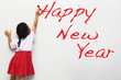 Girl writing happy new year