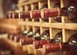 Red wine bottles stacked on wooden racks