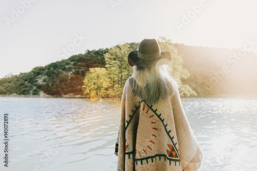 Boho style woman walking on lake - 145072893