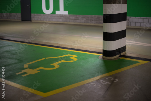 Poster Electric car parking place in public garage