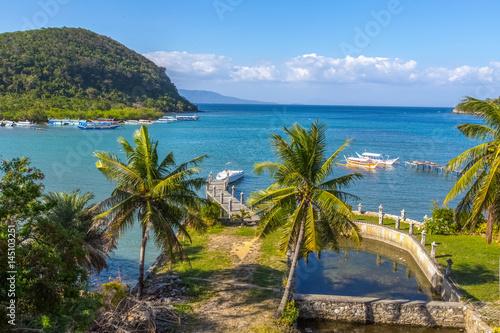 Plexiglas Schip Puerto-Galera, Philippines - March 20, 2017: view on Balatero Cove bay fishermans village and boats