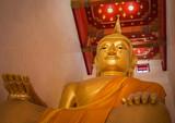 big golden buddha statue in public wat palelaiworaviharn temple at suphanburi thailand