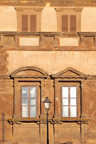 Beautiful Tuscany, Detail of Palazzo Campana facade in renaissance style, Colle Val d'Elsa, Siena district