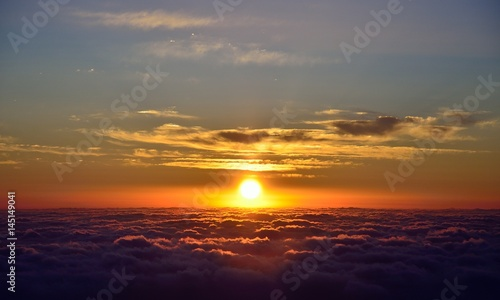 Beautiful sky at sunrise over the sea of clouds