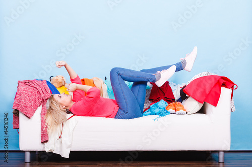 Plakat Woman does not know what to wear lying on couch