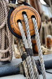 Ancient wooden sailboat pulleys and ropes detail - 145200223