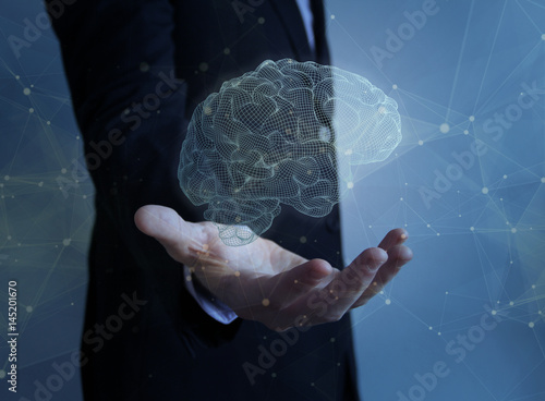businessman with brain over hand Poster