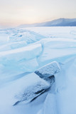 Turquoise ice floes. Winter sunset landscape
