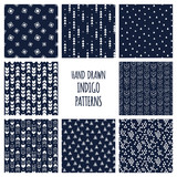 Set of hand drawn indigo blue and white patterns. Seamless vector triblal aztec backgrounds with triangles and arrows. - 145215822
