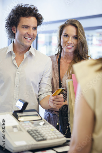 Couple Paying at a Shop Poster